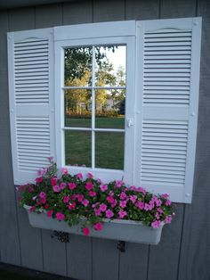 window flower box using shutter and old window for outside on our shed.