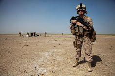 Marine Female Engagement Team officer provides security as Afghan residents are questioned and their vehicle searched for weapons and drug paraphernalia, Helmand Province U.S. Marine Corps (Robert R. Carrasco)