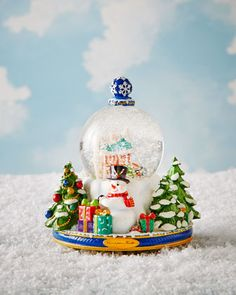 A Snowy Winter Day Snowglobe by Christopher Radko at Neiman Marcus.