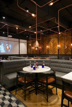back to back horseshoe-shaped booths with conduit fixed drop pendant lights PizzaExpress Restaurant, India designed Urban Studio