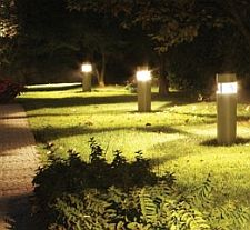 Bollard lighting and downlighters create an imposing look to any commercial square bollard lights aloadofball Images