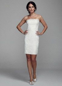 Stylish and chic, you will love the way you look and feel in this romantic lace dress!  Strapless all over lace bodice features ultra-feminine scalloped neckline and hem.  Available in Ivory.  Fully lined. Back zip. Imported polyester. Dry clean only.  To protect your dress, try our Non Woven Garment Bag.