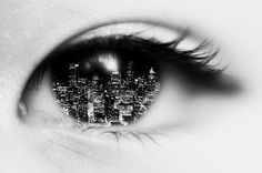 I found this really interesting. It looks like the city has been Photoshopped into the eye. This would require a lot of skills because they would have to get the curve correctly.  I also really love how it's all black and white so the city doesn't overpower the overall image.