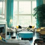 Dazzling Blue Living Room Idea with Blue Curtains and Huge Glass Windows also White Fabric Sectional Sofa Set Feat Black Yellow Pillows Near Calm Coffee Table and Blue Fabric Ottoman Idea a part of  under Living Room