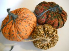 DIY Large Yo Yo Fabric Pumpkins...  yo yo's are so simple to make, even non crafters or non sewers can do these. just cut out a large circle, run a needle and embroidery thread along the edge and tighten.