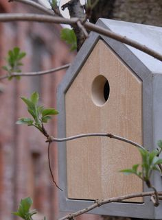 concrete and wood bird house
