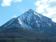 This mountain is located near Sutton Alaska, basically a stop in the highway. The mountain's name is King Mountain, and it towers over the Matanuska river.