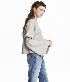 Check this out! Slightly shorter, wide-cut top in sweatshirt fabric with a ribbed stand-up collar and extra-long sleeves with a ribbed seam and flared cuffs. - Visit hm.com to see more.
