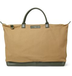 Designed specifically for stylish men on the go, this large tote bag from WANT Les Essentiels de la Vie has been crafted from the finest materials to look better with use. The brown organic cotton-canvas body and contrast green leather trims set a sophisticated tone, while the detachable shoulder strap makes it a versatile investment. So whether away for business or pleasure, this piece will ensure you look your best.