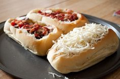 Deep Dish French Bread Pizzas...great idea! Just hollow out and fill with toppings!  Might be good for Stromboli's!