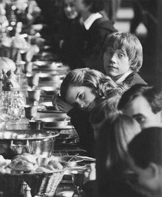 harry potter. emma and rupert as ron and hermione in the great hall.