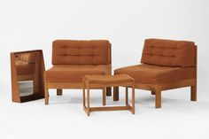 A pair of Conran teak Lounge chairs, with orange upholstered fabric, a matching stool and a teak wall mirror, with an intregral shelf