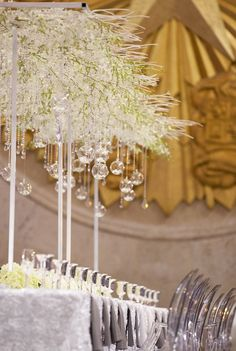 Wedding Centerpiece Ideas - clear glass ornaments handing from tall centerpieces of crystal branches
