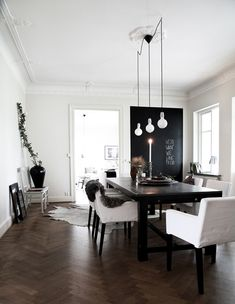 the trendiest room ever: chevron floors, monochrome scheme AND black as an accent color.