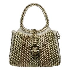 by Pretina Artes Lacres - Winner of the Best Socially Responsible Handbag - 2011 Independent Designer Handbag Awards.  Genius - handmade from soda can tab tops - Wow.