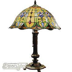 Tiffany Tafellamp Tinia Flower  Een bijzonder mooie tafellamp. Helemaal met de hand gemaakt van echt Tiffanyglas. Dit originele glas zorgt voor de warme uitstraling. De voet is vervaardigd van brons. Met 2x grote fitting (E27). Met schakelaar aan de kap. Afmetingen: Hoogte: 53 cm Diameter Kap: 40 cm