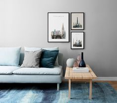 Shades of blue and grey | minimalist living room with a pale blue sofa | wall gallery by Desenio | IKEA Stockholm rattan coffee table | IKEA Söderhamn sofa with a Bemz cover in Duck Egg Blue Brera Lino linen by Designers Guild