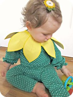 A comfy baby sunflower costume