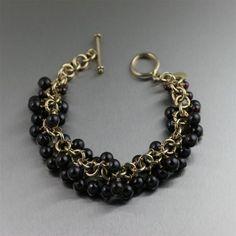 Handmade 14K Gold-filled Garnet Chainmail Bracelet http://www.johnsbrana.com/14k-gold-filled-garnet-chainmail-bracelet.html  $425.00 #GemstoneBracelets #GarnetBracelets