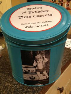 Cool Idea..1st Birthday Time Capsule - spray paint an old tin and mod podge a picture from baby's one year shoot and a message.  Ask everyone to bring something for it.