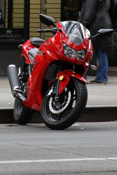 Red Kawasaki Ninja Motorcycle on the streets of New York by Julia Rozental