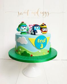Handmade Robocar Poli figurines for this cute little cake. Love the clean lines!