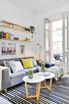 living room | light, bright room with grey sofa and large monochrome striped rug