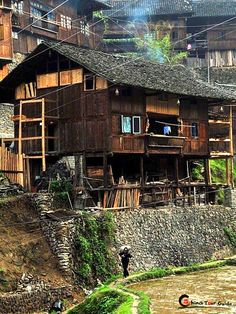 Xijiang Miao Village | Miao's folk residence--stilt house (Diaojiao House), built on the stilts of different heights.