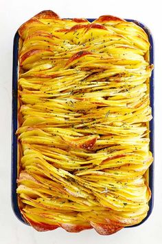 Crispy roasted leaf potatoes in a baking tray.