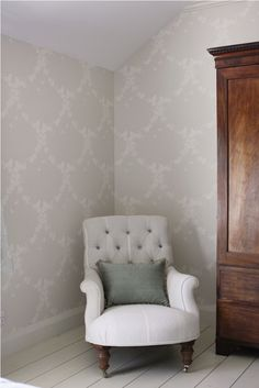 Apple Blossom - Pearl/ Ivory wallpaper works perfectly with the susie watson designs button backed armchair, shown here upholstered with Grey Ivory Oxford Fabric. #susiewatasondesigns #susiewatson