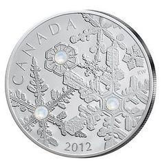 Svarovski-Elemente verzieren diese kanadische Silbermünze mit Schneeflocken-Motiv... darüber freut sich jeder Münzsammler