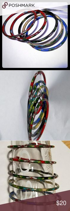 CLOISONNE BANGLE SET Beautiful set.  Each bangle is unique in color and design.  Crafted so well that you would never know the difference from authentic.  Excellant condition Jewelry Bracelets