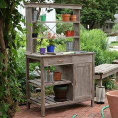 Find it at the Foundary - Rustic Outdoor Kitchen $395.  Outdoor potting bench made from acacia wood  Can double as an outdoor buffet  Work surface with a removable bin  2 upper and 2 lower shelves  1 cabinet and 1 drawer  Driftwood finish  Weighs 110 pounds  Dimensions: 42L x 23W x 72H inches