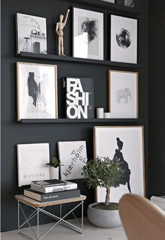 Monochrome picture frames on a black feature wall