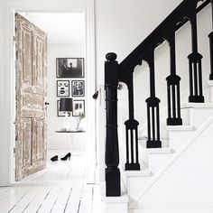 Black bannisters and white stairs in the stunning monochrome home of Swedish stylist Jenny Hultgren / Bohemdeluxe.