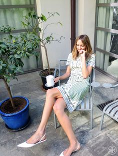 Candela Novembre wearing Tory's Talia dress in her Milan backyard