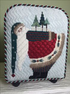 Pine Tree Santa by Pat Thode. Stitched in 2003.