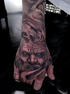 26 3D Portrait Hand Tattoo