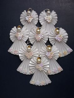 How to make a paper angel for the christmas ornament more articles Origami Angel ornaments By rheajm (No other information. Origami Angel made with 3 one dollar bills. Each wing is a origami angels…cute ornaments or gift tag, decoration. Divine And Beau Christmas Angels, All Things Christmas, Christmas Holidays, Christmas Decorations, Christmas Ornaments, Origami Christmas, Crochet Christmas, Birthday Decorations, Arts And Crafts