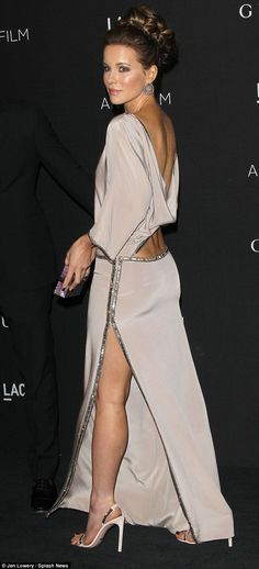 Kate Beckinsale teamed her standout dress with an ornate hairdo and silver earrings at the LACMA Art + Film Gala http://dailym.ai/1DMjl91