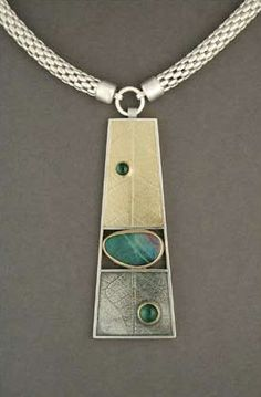 Carol Henning Metalsmith. I like the join of the chain pieces and the pendant.