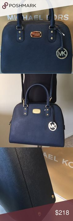 MICHAEL KORS NEW LARGE DOME BAG  AUTHENTIC MICHAEL KORS NEW WITH TAGS NEVER USED LARGE DOME HANDBAG/ SHOULDER/ CROSSBODY BAG 100% AUTHENTIC. SO STUNNING AND STYLISH AND TOTALLY ON TREND. THIS IS THE LARGEST OF THIS MODEL. VERY ROOMY BAG IN DARK NAVY. THE BAG HAS A REAR OUTSIDE POCKET AND 5 INTERIOR WALL POCKETS IN THE LARGE MAIN COMPARTMENT. THIS BAG MEASURES 13 INCHES WIDE BY ALMOST 10 INCHES TALL AND BERY DEEP. HAS HANDLES AND A LONG REMOVABLE AND ADJUSTABLE SHOULDER / CROSSBODY STRAP…