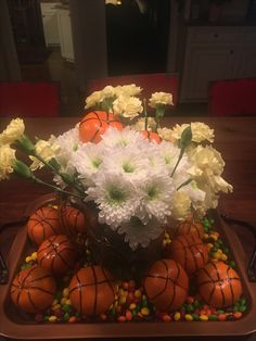 If you need a basketball centerpiece, just draw a black sharpie on a clementine...I had to google how to draw a basketball. Easy!