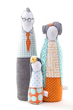 This Family portrait is part of TIMO-HANDMADE a small design line.  Sewn with an eye for detail and a touch for fabric. Being hand-made, each and