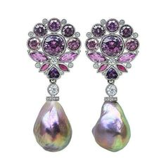 These incredible platinum earrings featuring Pearls accented with rhodolite Garnet, Spinel, pink Sapphires and Diamonds from AGTA Member, @featherstonedesign