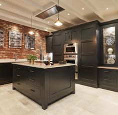 Our dusted oak internal finishes complement the ever popular paint colour Nightshade, brilliantly. When combined with the warmth and raw texture of the exposed brickwork, you're left with a stunning colour scheme that works so well. Exposed Brick Kitchen, Brick Wall Kitchen, Exposed Brick Walls, Kitchen Flooring, Jeff Kitchen, Kitchen Cabinets, Shaker Style Kitchens, Black Kitchens, Luxury Kitchens