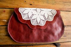 NZFINCH Rich Red Leather Clutch with vintage doily. via Etsy.