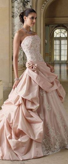 This dress is stunning! Not a fan of a pink wedding dress but it's pretty :)