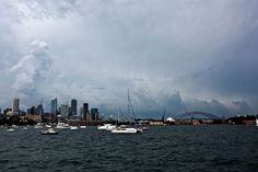 Storm clouds roll in over the city as seen from Darling Point.