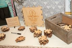 wooden puzzle piece alternative to a traditional wedding guest book